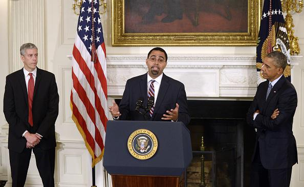 WASHINGTON, DC - OCTOBER 02: Deputy Education Secretary John B. King Jr. (C) delivers remarks after being nominated by U.S. President Barack Obama (R) to replace outgoing Education Secretary Arne Duncan (L) in the State Dining Room at the White House October 2, 2015 in Washington, DC. Obama praised the work of Duncan, one of the few remaining members of the president's original cabinet. (Photo by Olivier Douliery - Pool/Getty Images)
